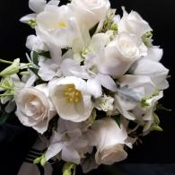White Dendrobium Orchids, Tulips, Roses and larkspur create this beautiful Bouquet
