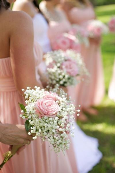These bridesmaids bouquets are simple but, beautiful. They include babies breath and pink roses